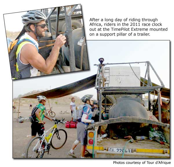 After a long day of riding through Africa, riders in the 2011 race clock out at the TimePilot Extreme mounted on a support pillar of a trailer.""